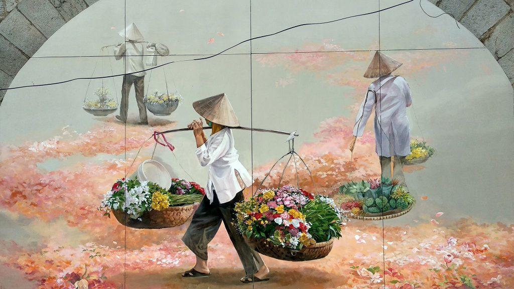 Malunek przedstawiający typowy sposób transportu towarów w Wietnamie